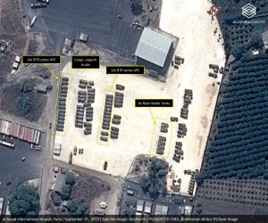This Tuesday, Sept. 15, 2015 satellite image with annotations provided by GeoNorth, AllSource Analysis, Airbus shows Russian tanks and armed personnel carriers at an air base in Latakia province, Syria. Russia on Thursday strongly urged the United States and its allies to engage the Syrian government as a